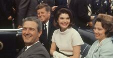John F. Kennedy & Gov John Connally and his wife Nellie in limo at in airport