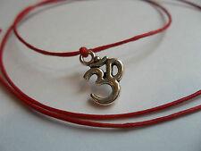 Red string tie on bracelet om aum yoga meditation tantra shiva yogi kama sutra