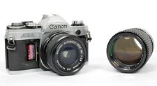 Canon AE-1 35mm SLR Film Camera with 28mm +135mm lenses