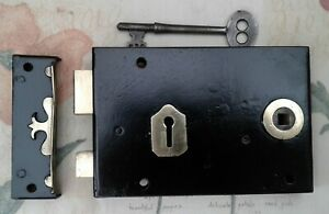 STEEL AND BRASS RIM LOCK WITH CAST IRON BRASS EDGED KEEP AND KEY