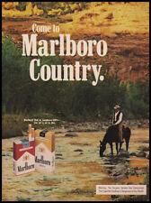 Marlboro cigarettes print ad 1974 rider & horse, stream, hillside