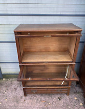 The wooden display cabinet is in good condition
