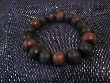 Wonderful wooden beaded bracelet elasticated black & brown coloured