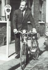 1960 Wire Photo race driver Stirling Moss parks his bicycle in streets of London