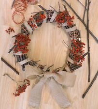 wreath on the front door, wreath with branches and ribbons, forest wreath