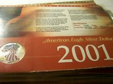 2001 AMERICAN SILVER EAGLE $1 COLORIZED, WITH HISTORY CARD/ CERT OF AUTHENTIC.