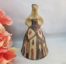 Hand made, painted mud clay pottery bell. Lady in dress