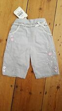 NEW. BHS Bambini girls 0-3mths grey cotton,jersey lined embroidered trousers.