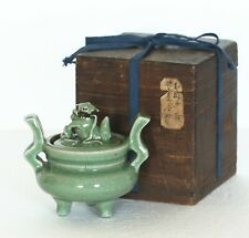 A Chinese antique celadon censer with wooden lid