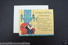 # I 646- Unused 1900's Xmas Greeting Card Colorful Man Sitting on Chair Smoking