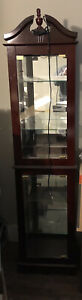 curio cabinet cherry stained with glass shelves with light.