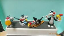 3 Tweety Bird and Sylvester figures and 1 Sylvester