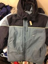 NIKE WINTER COAT IN NAVY IN small 34/36 or LARGE 40/42 42/ INCH MID LENGHTAT £30