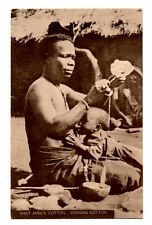 WEST AFRICA, SEMI-NUDE NATIVE WOMAN WITH CHILD SPINNING COTTON, c 1904-14