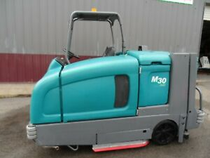 Tennant M30 sweeper/scrubber L.P. Totally Serviced G.M. Eng. Low hr.