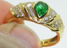 118CT 0.34CT EMERALD 0.25CT DIAMOND RING 18 CARAT YELLOW GOLD PEAR CLUSTER RING