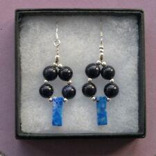 Orecchini di lusso con gemme blu tondi in argento