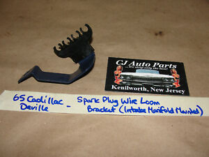 OEM 65 Cadillac CARBURETOR / INTAKE MANIFOLD MOUNTED WIRE LOOM & BRACKET