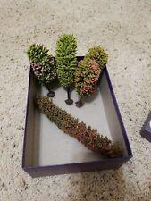 Minature trees shrub Liliput Lane houses display Spring Railroad model