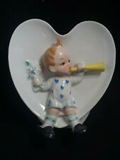 Baby in Heart Blowing Horn Wall Pocket