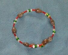 Brown Hawaiian Job's Tears bracelet with silver lined seed beads red green gold