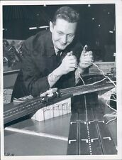 1963 Man Holds Controls to Vintage Toy Electric Race Car Track Press Photo