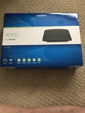 Open Box New Linksys E1200 N300 Wi-Fi Router and Used Netgear N300 Modem Router