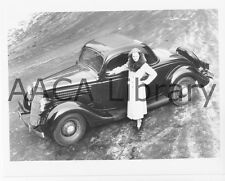 1935 Ford Three Window Coupe Deluxe, Factory Photo (Ref. # 41938)