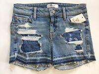 Guess pour Femme Jeans Skinny Court en Bleu avec Destroy Taille 27
