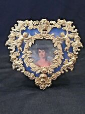 EXQUISITE ANTIQUE HEART SHAPED FRAME WITH CUPIDS