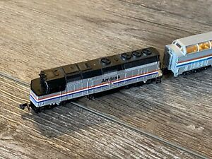 N scale train set used, multiple engines, many carts and tracks, some extras
