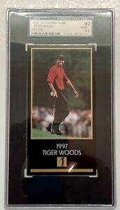 1997-99 Grand Slam Tiger Woods Rookie RC SGC 92 8.5 Sports Trading Card