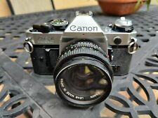 Canon AE-1 Program 35mm SLR Film Camera with Canon FD 50mm Prime Lens