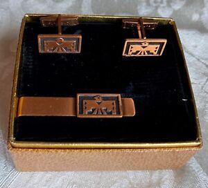 Vintage tie bar/cuff links set,copper w/ Thunderbird designs,pat.pending,in box