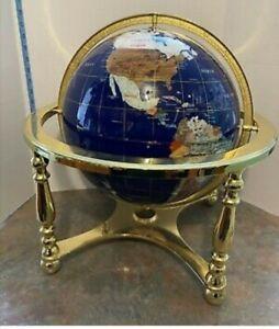 Brand new boxed black sea 220mm lapis globe with semi precious stones.