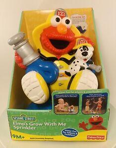 Elmo Grow With Me Sprinkler Fisher Price 2007 Mattel Sesame Street NIB 9 Mo +