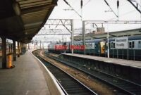 PHOTO  1991 MANCHESTER  PICCADILLY RAILWAY STATION 6 CAR CLASS  304 IN PLATFORM