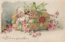 GREETINGS:Bonne fete -embossed  baby in a basket