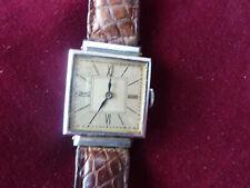 jolie petite montre d'homme,vintage,fonctionne,25x25mm,fond acier