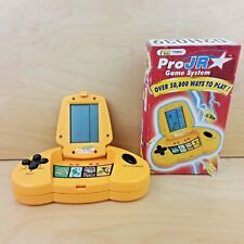 PRO JR HAND HELD COMPUTER GAME SYSTEM 50,000 WAYS TO PLAY WITH BOX & INSTRUCTION