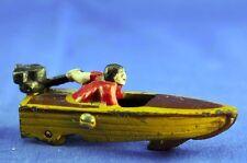 VINTAGE CAST IRON MAN IN SPEED BOAT ON WHEELS