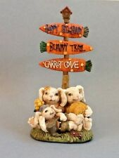 A Cute Easter Bunnies Figurine with Trail Signs