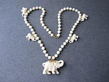 Vintage elephant medallion & dangles flowers beads creamy plastic necklace