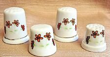 4 VINTAGE PORCELAIN THIMBLES w/ RED FLOWERS