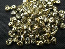 100 ST. Rocailles duo beads 5x2mm gold klar 10203