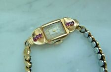VINTAGE LADIES 14K YELLOW GOLD AND RUBY  WITTNAUER WATCH