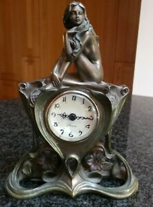 Veronese Bronze finish nude female sitting on a base with a clock