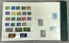 Collection of Irish Stamps in Green Clipped Stamp Book - Approx 150 - #146