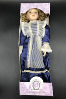 Classical Treasures Collection, Genuine Porcelain Doll, DarkBlue Dress with Lace