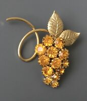 Vintage  grape cluster brooch in gold  tone metal with crystals